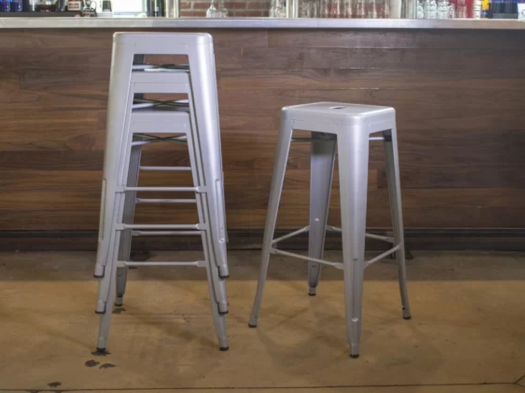 silver colored stackable metal bar stools