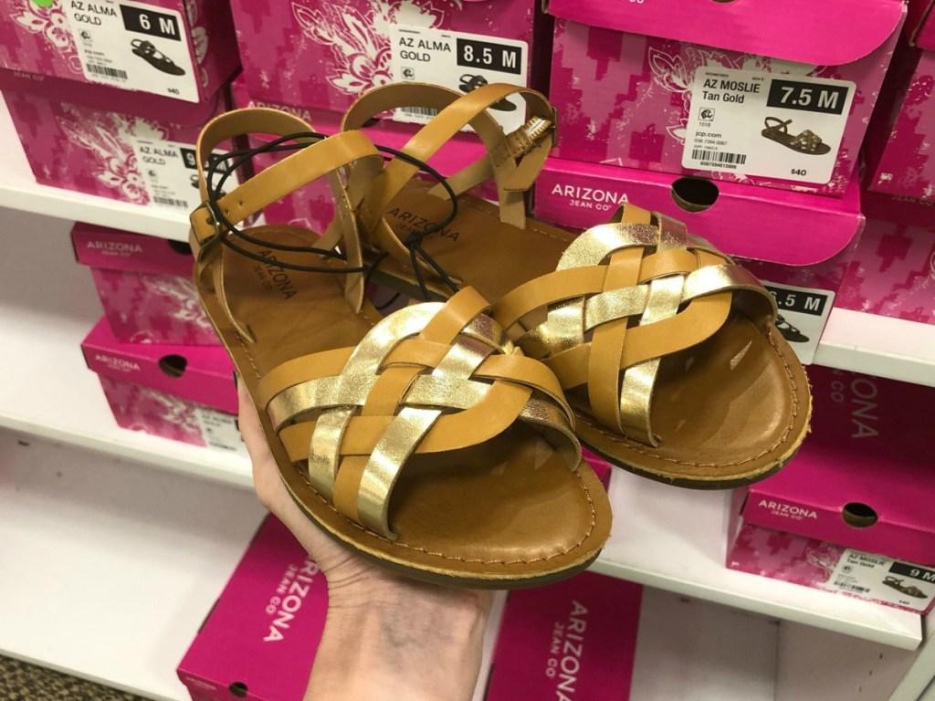 Arizona Moslie Sandals held up in shoe aisle