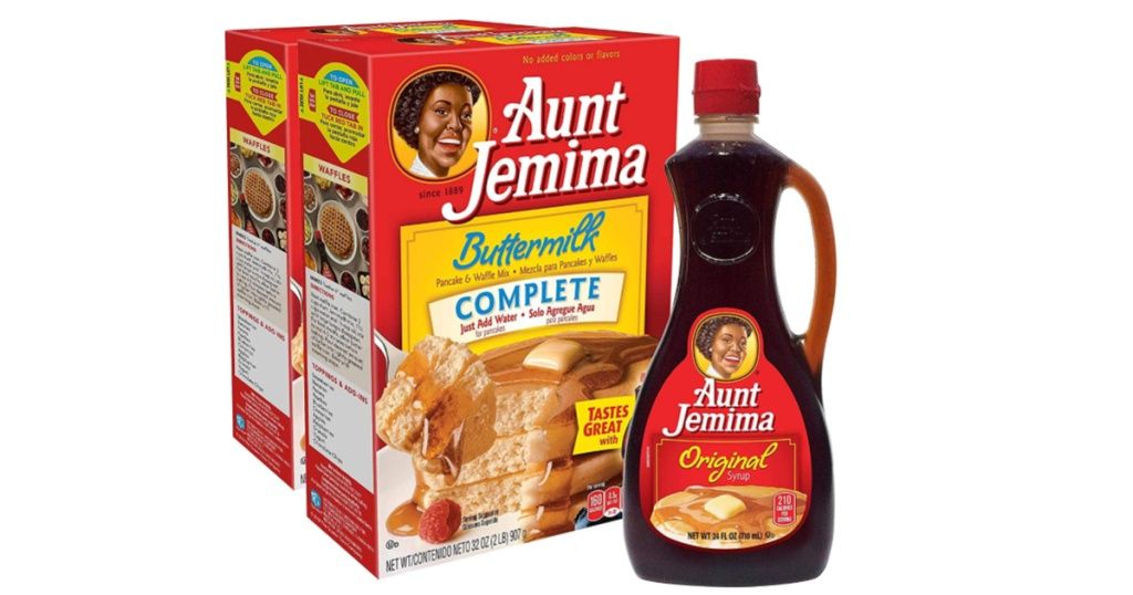 2 big boxes of aunt jemima pancake mix and bottle of syrup
