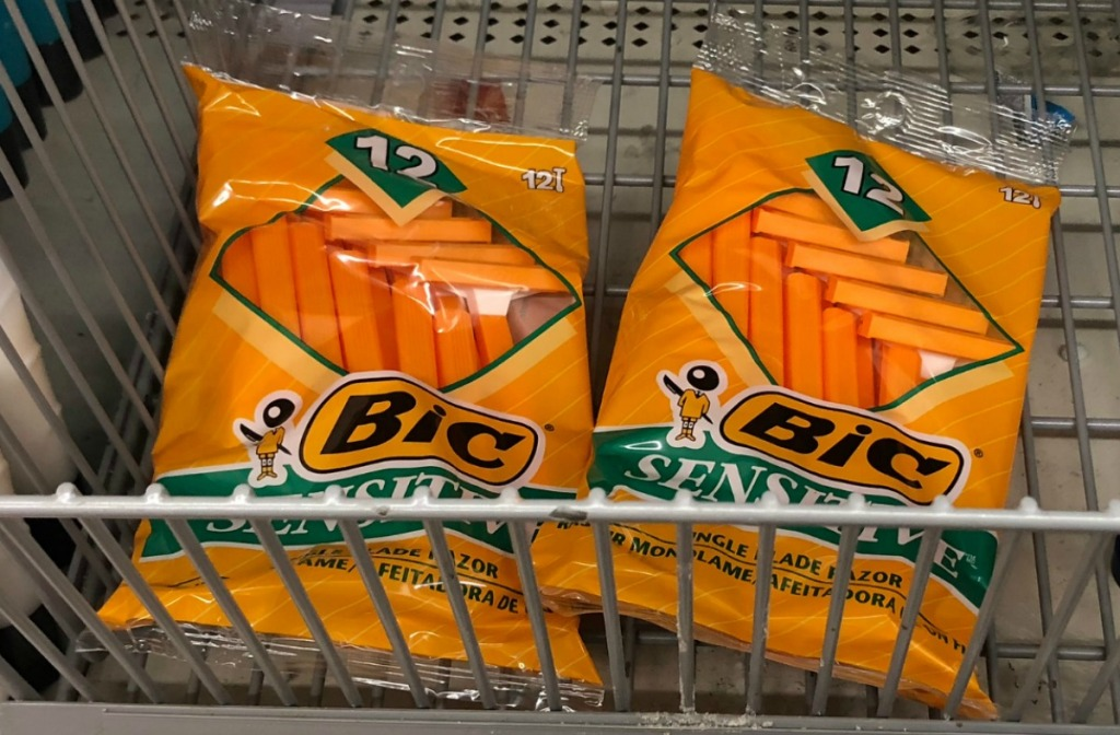 BIC brand men's razors for sensitive skin in orange packaging on store shelf