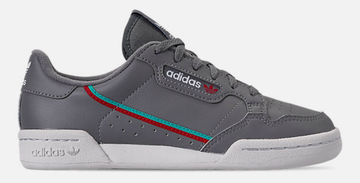 grey adidas sneakers with blue and red stripe
