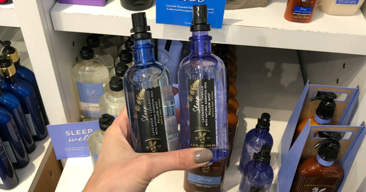Woman holding bottles of Bath & Body Works Sleep Aromatherapy