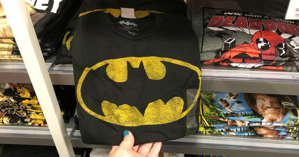 woman holding men's Batman tee at Target