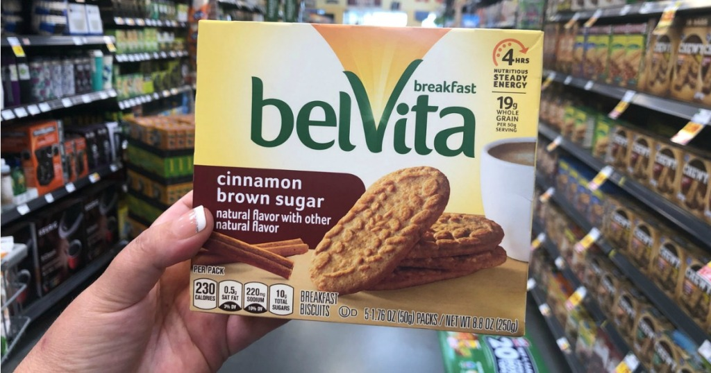 Hand holding up Belvita Breakfast Biscuits in store aisle