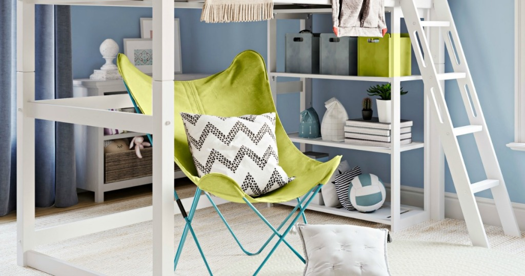 white loft bed in bedroom with green chair under loft bed