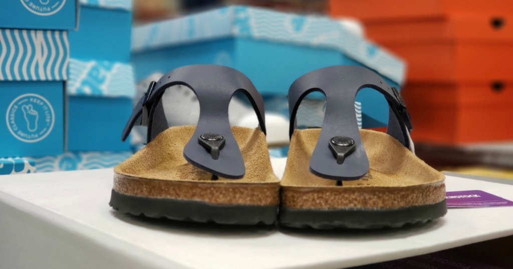 Birkenstocks Gizeh Sandals on display table at Sam's Club