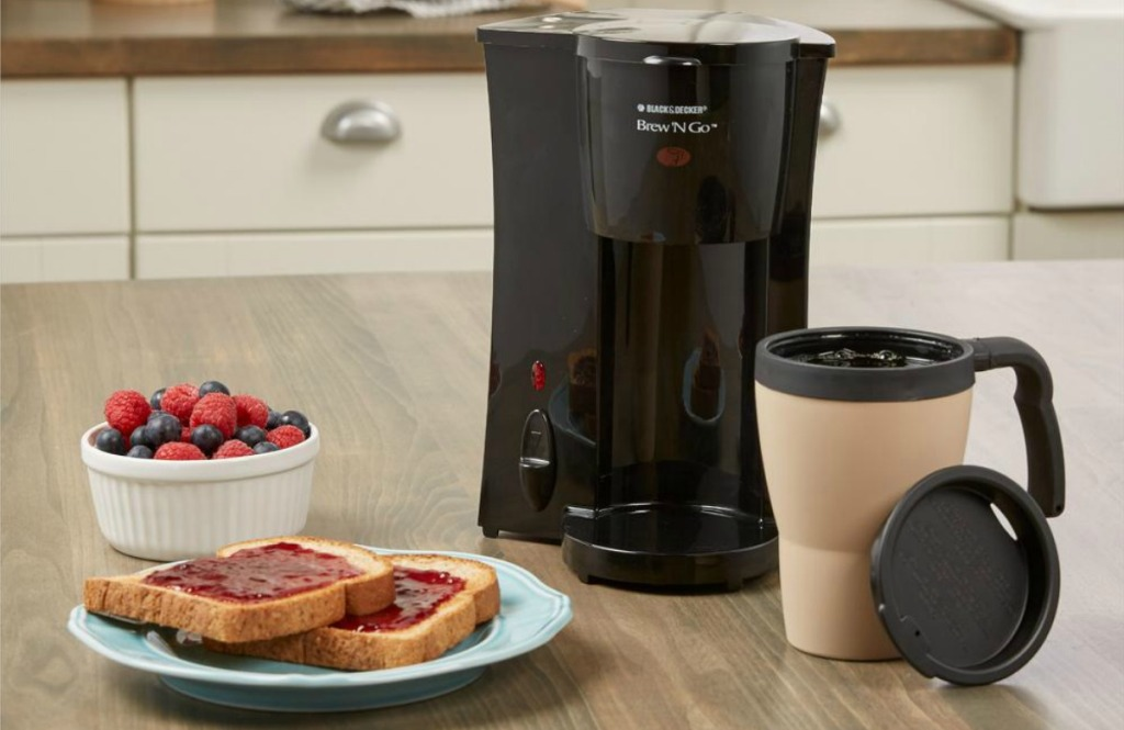 Black + Decker Brew 'n Go on kitchen counter with toast and berries