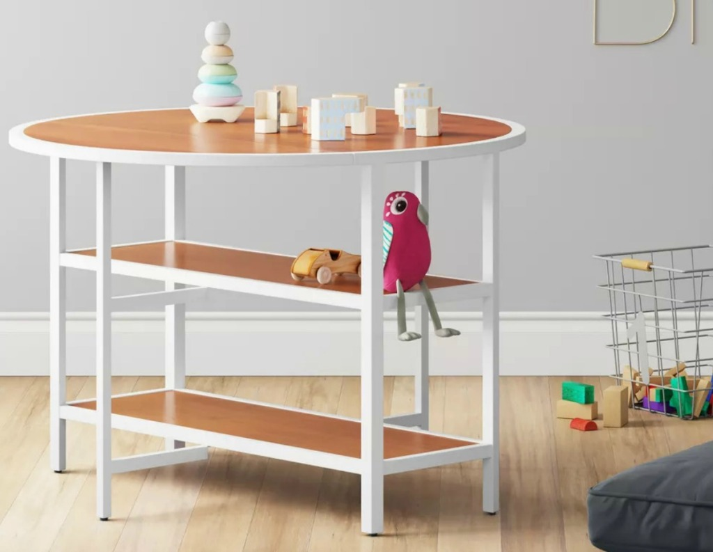 Kids Activity table in bedroom with grey walls and hardwood floors