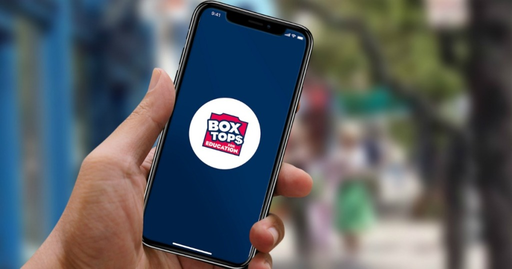 man holding cell phone with Box Tops for Education logo on the screen