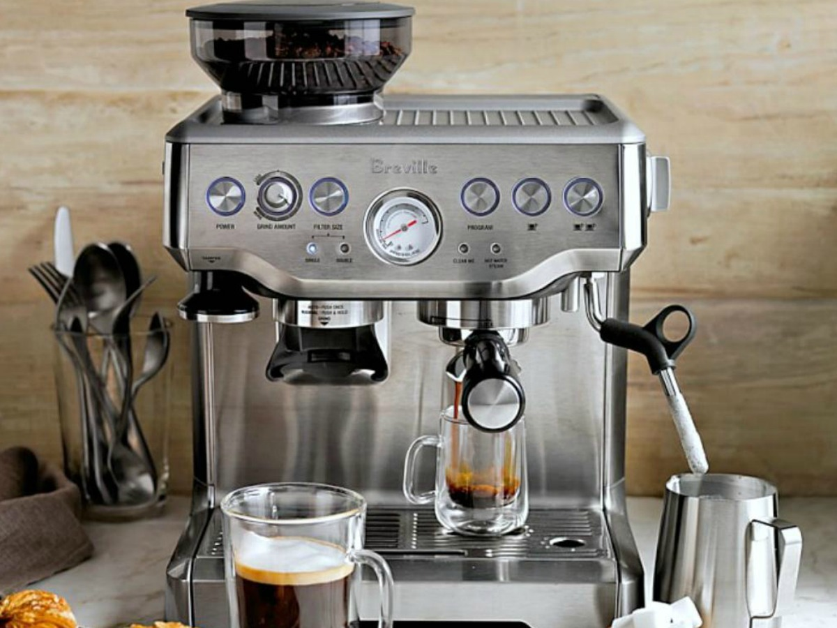 breville espresso maker on counter with accessories