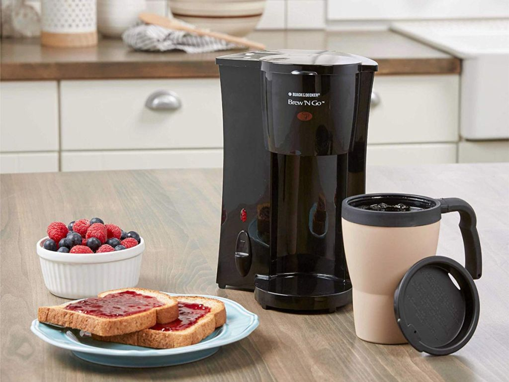 Brew'n Go Black and Almond Single Serve Coffee Maker with Filter with mug, toast with jam and berries