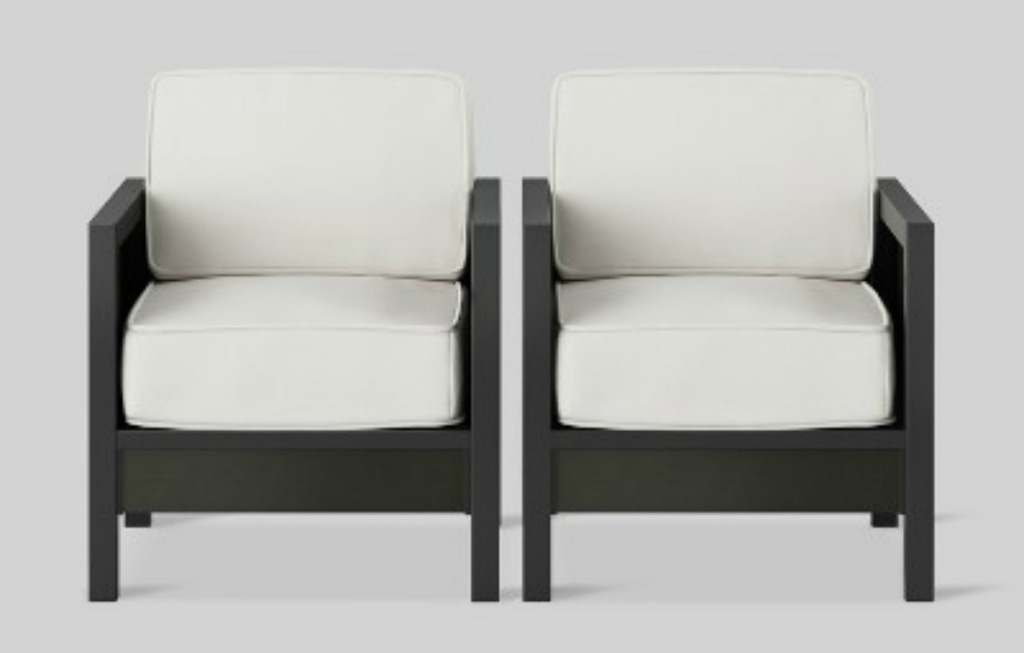 two patio club chairs with white cushions