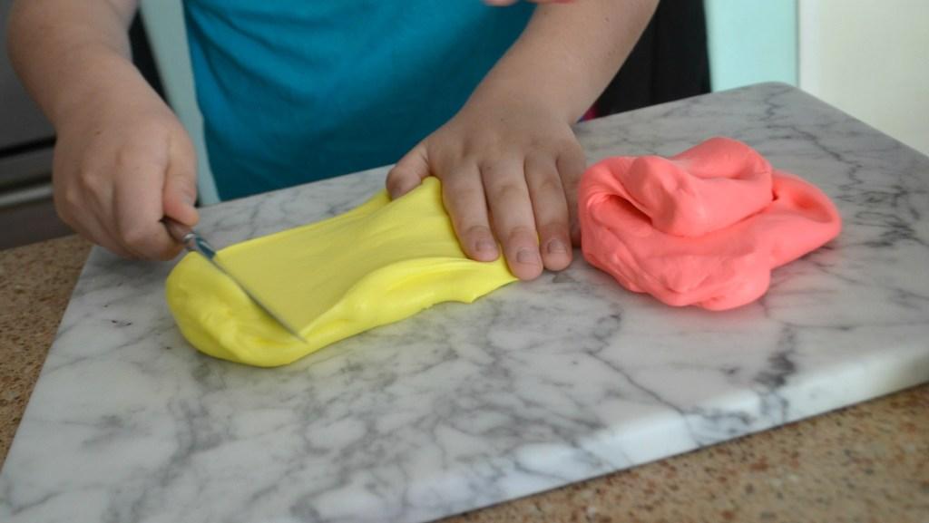 girl making homemade slime