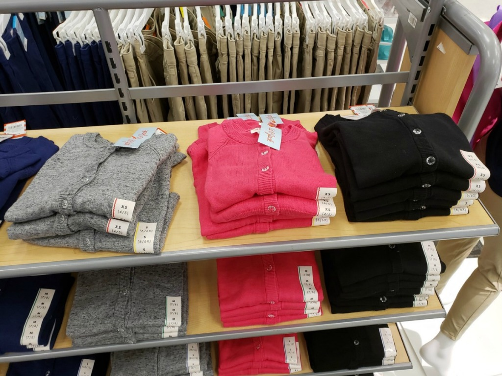 grey pink and black cat and jack sweaters on store shelves