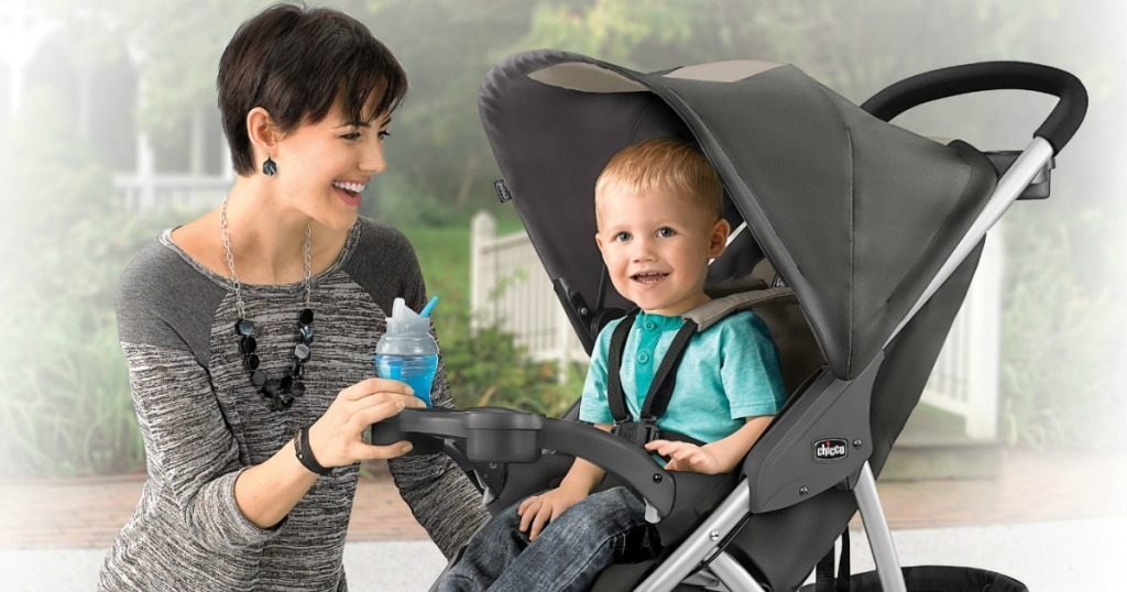 Woman with toddler boy in stroller