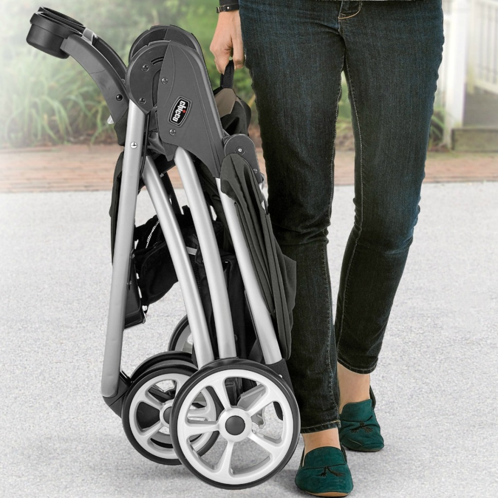 Woman standing with folder stroller