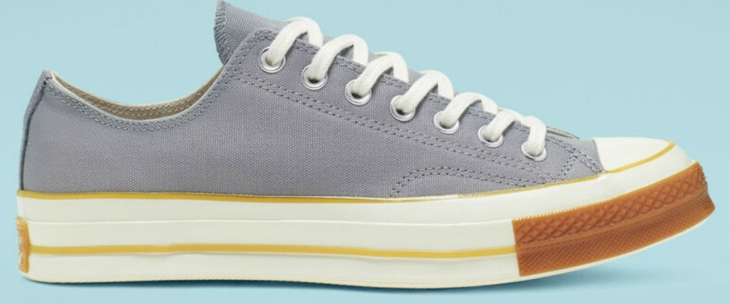 blue converse with white and brown sole
