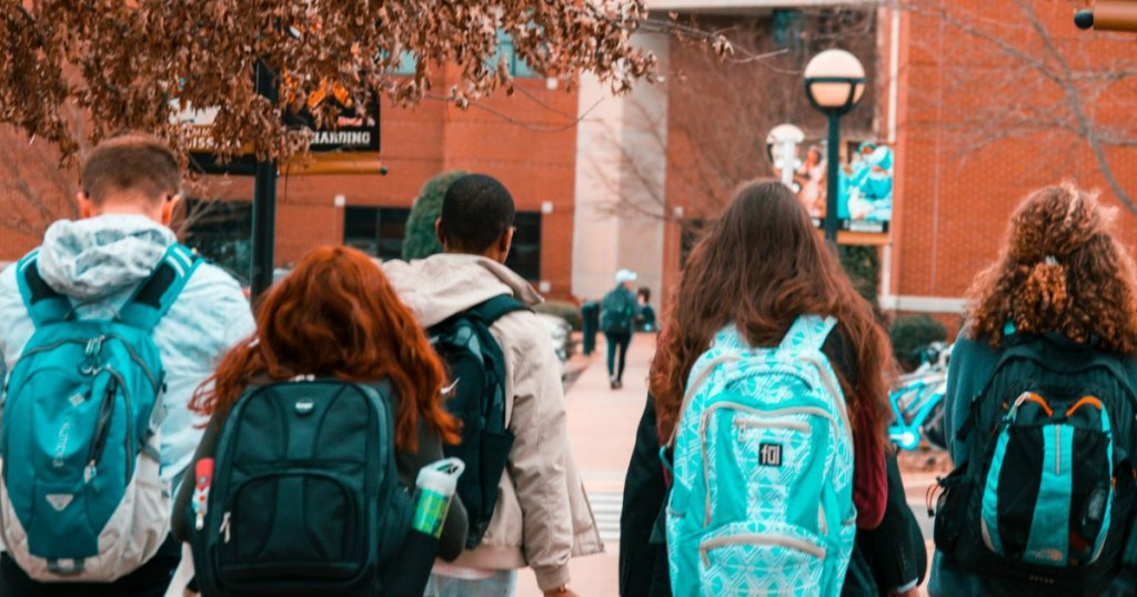 college students with backpacks headed to class