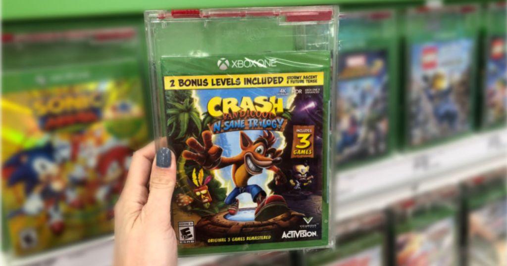 hand holding Crash Bandicoot N. Sane Trilogy Video Game in target