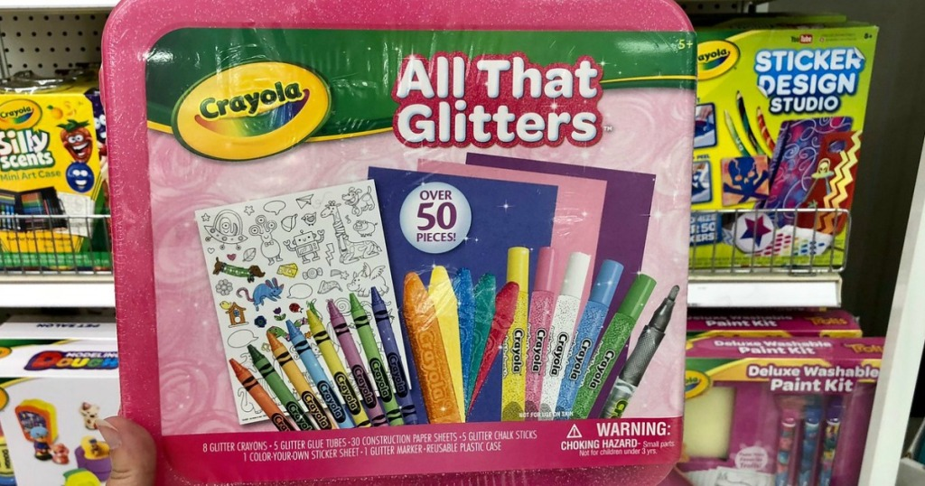 Crayola All That Glitters 50-Piece Art Case infront of other Crayola sets in store