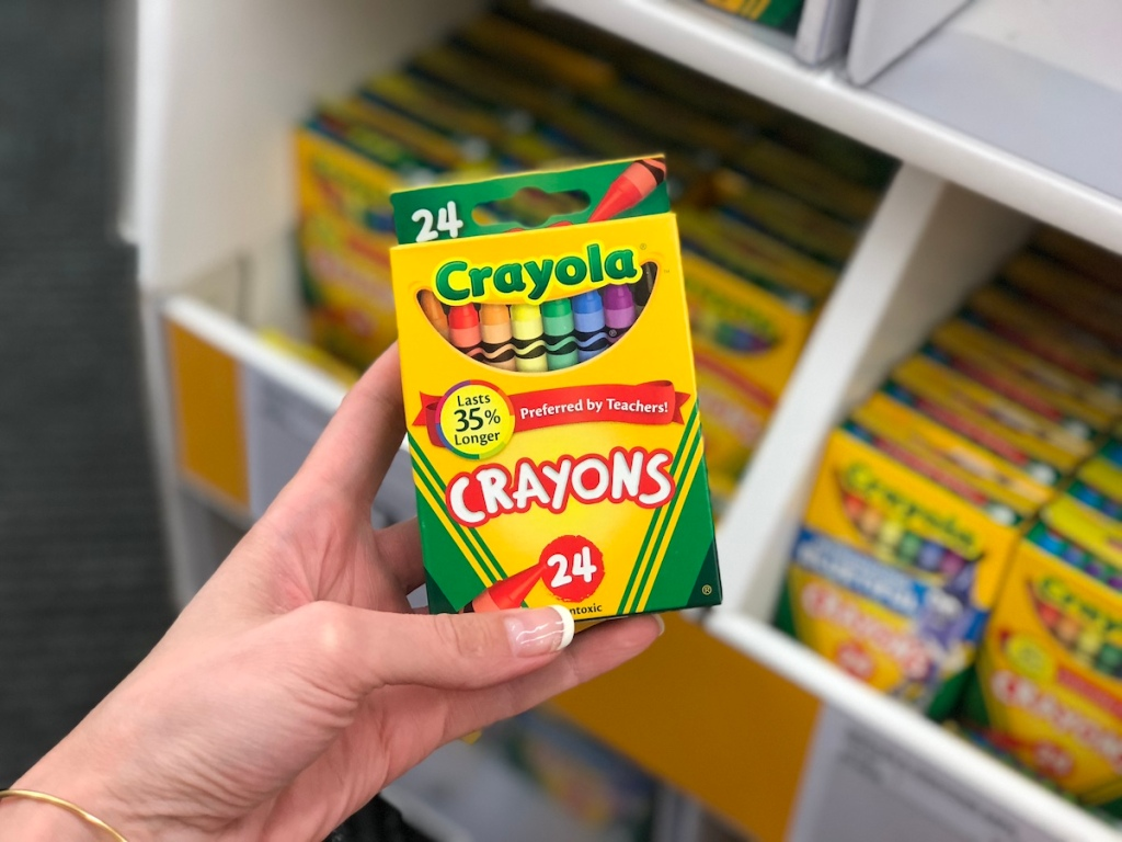 hand holding Crayola Crayons at staples