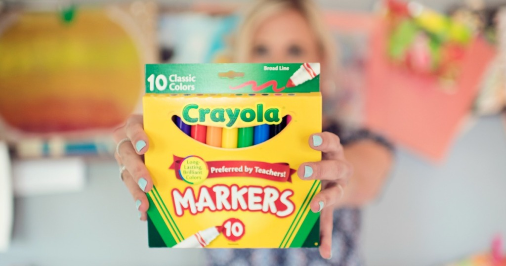 collin holding a 10-count pack of Crayola markers