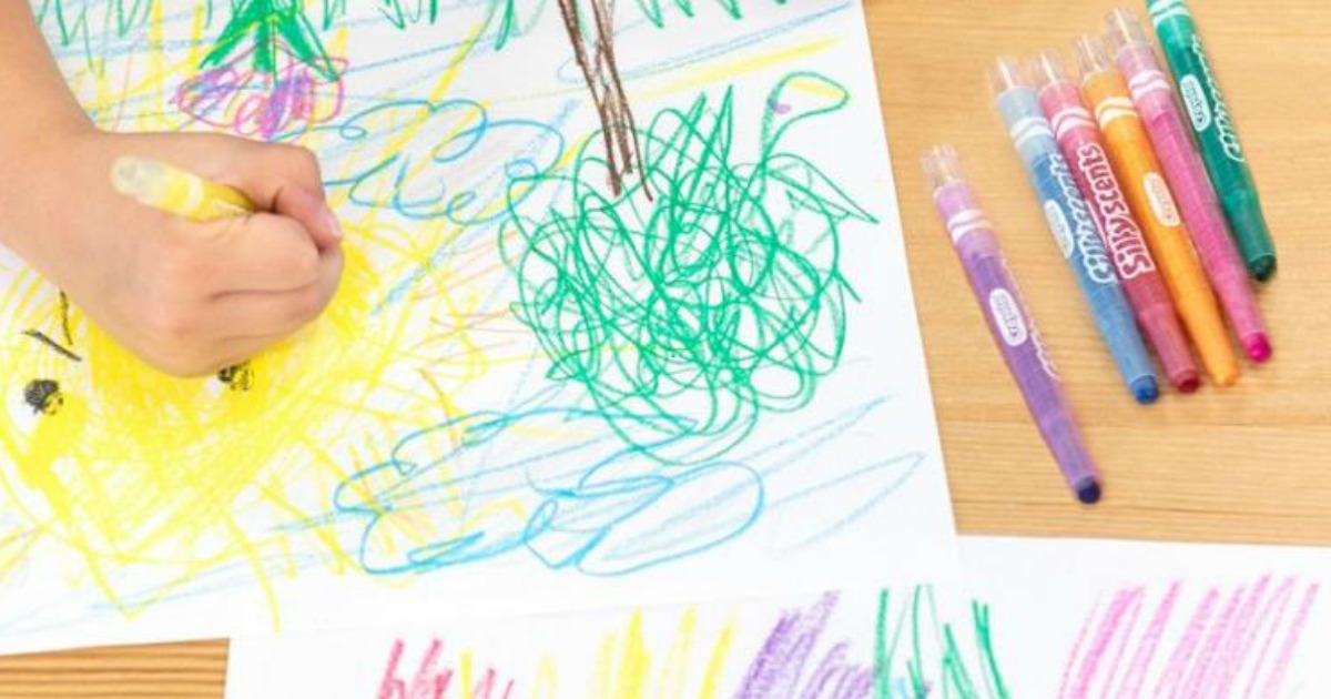 Kid drawing picture with Crayola Silly Scents Twistable Crayons