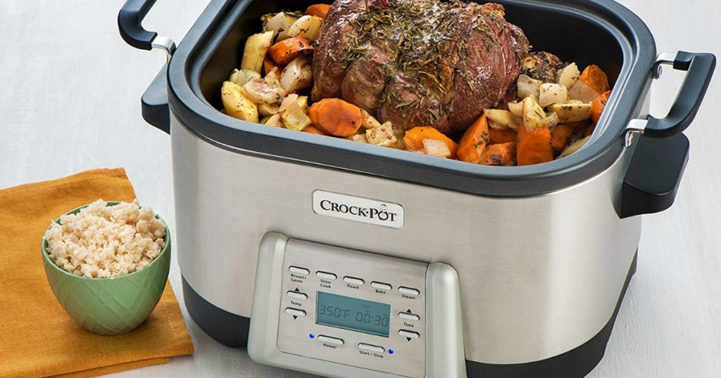 Extra large crock-pot filled with a pot roast dinner