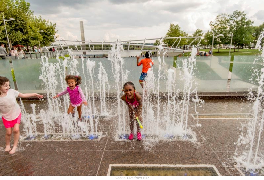 kids playing on splash pad park with water