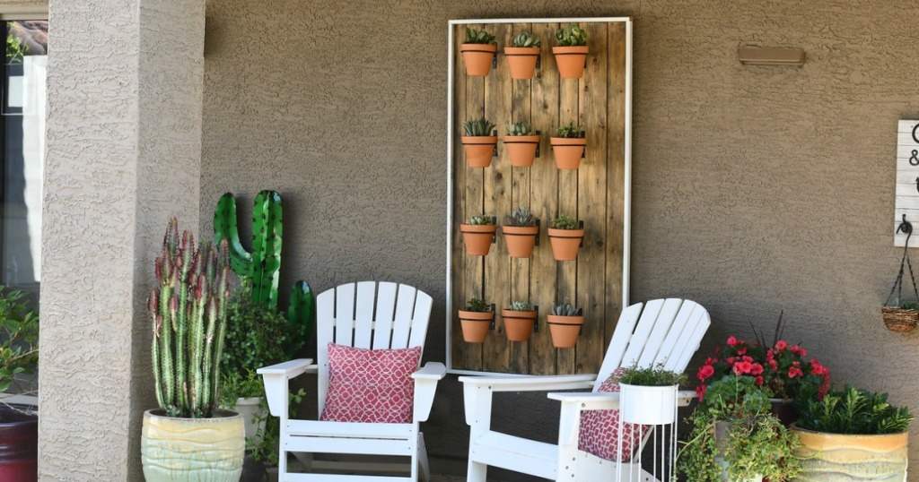 hanging succulent wall on patio with chairs