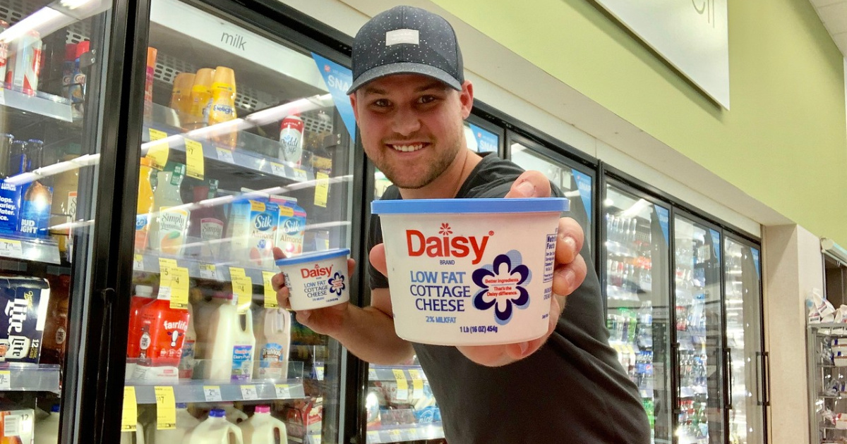 man holding daisy cottage cheese at walgreens