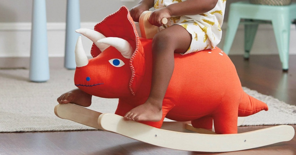Toddler riding dino rocker