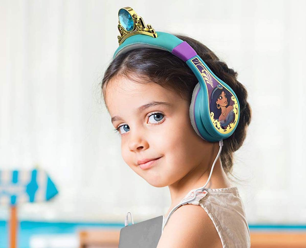 girl wearing Disney Aladdin headphones