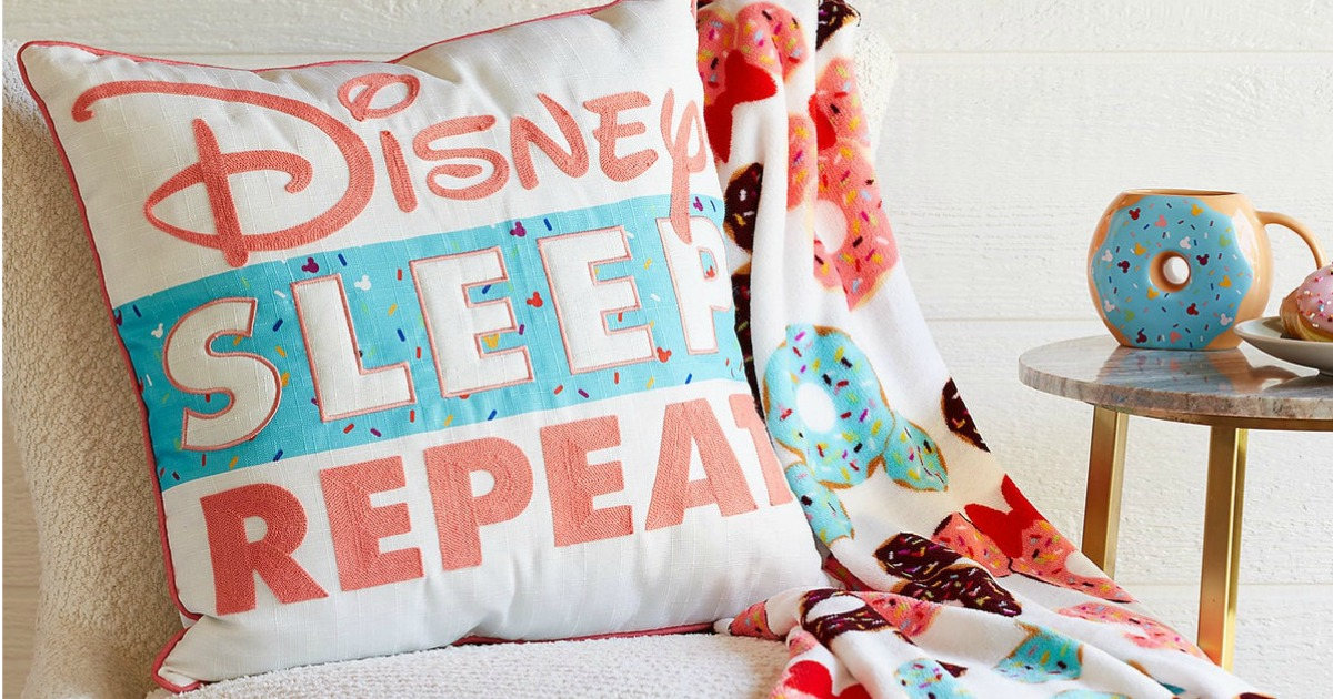 Disney Sleep Eat Repeat Pillow on chair with matching blanket on sale suring shopdisney friends and family sale