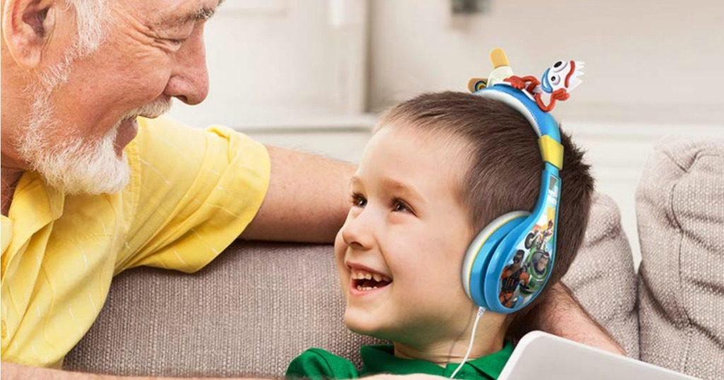 child wearing Disney headphones next to parent