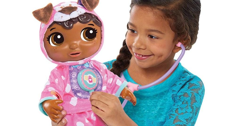 Girl holding Baby Doc McStuffins Doll