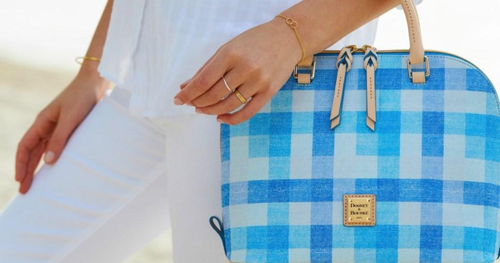 woman holding Dooney & Bourke purse