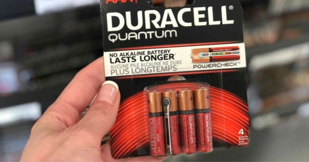 Hand holding Duracell Quantum Batteries