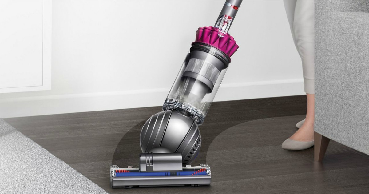 woman using Dyson Ball Vacuum