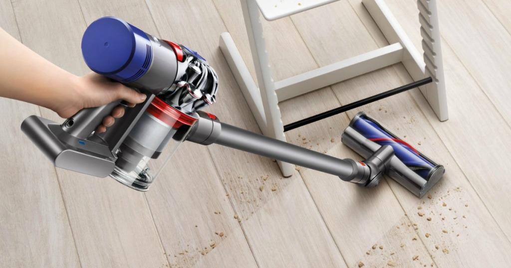 Dyson V7 Motorhead Extra Cordless Stick Vacuum Cleaner cleaning crumbs on wood floor