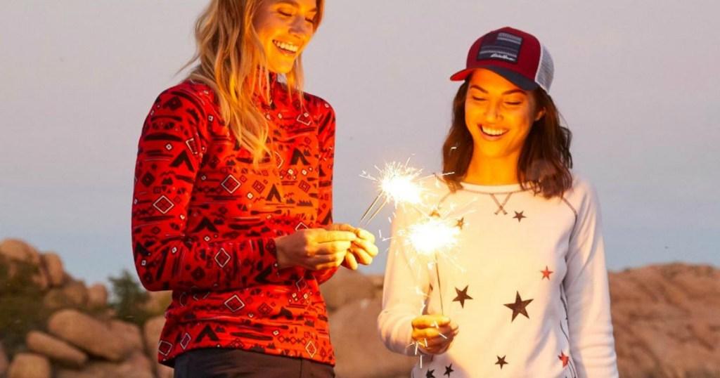 Women standing in Eddie Bauer Clothes with sparklers