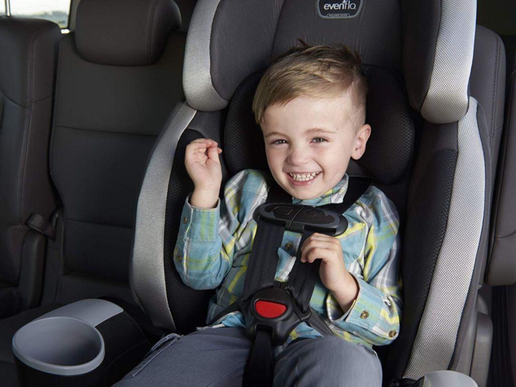 Boy sitting in Evenflo Maestro in car
