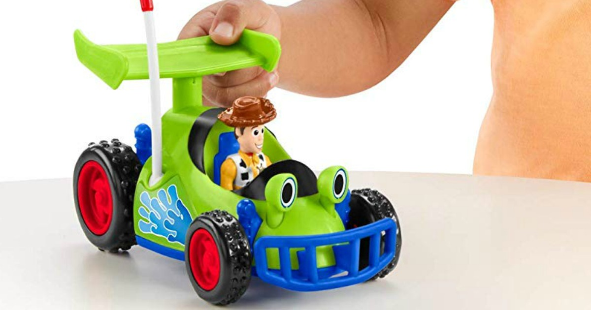 child playing with RC and Woody from Toy Story