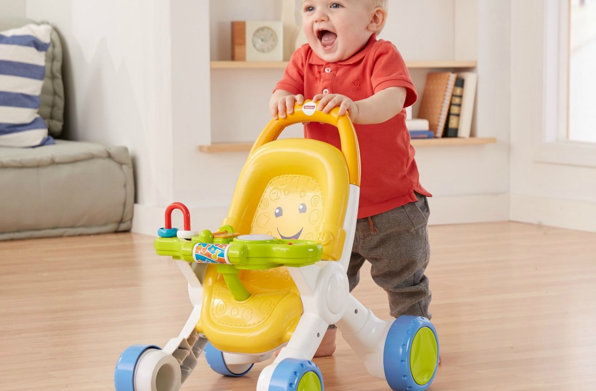 toddler boy pushing Fisher-Price Stroll & Learn Walker