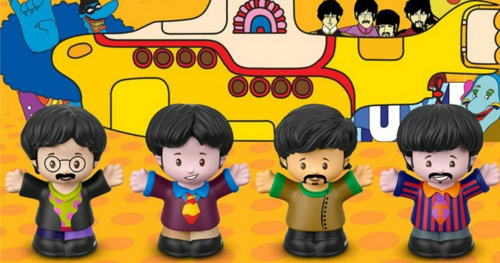 the beatles little people figures with yellow submarine behind them