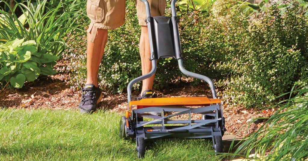 man pushing Fiskars StaySharp Max Reel Mower