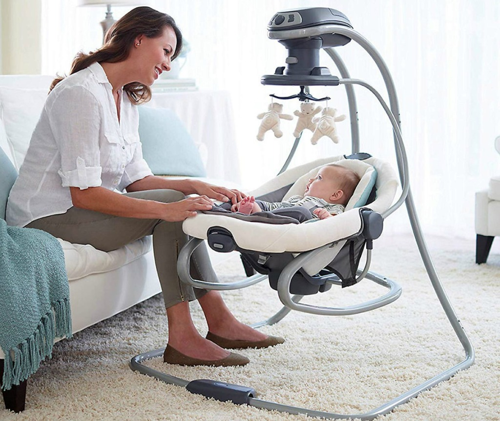 Mom with infant in a Graco duetsoothe swing rocker