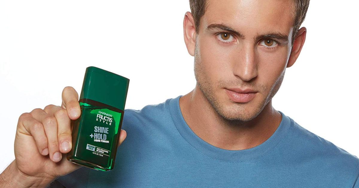 man holding Garnier Liquid Style Pomade Mask shine and hold
