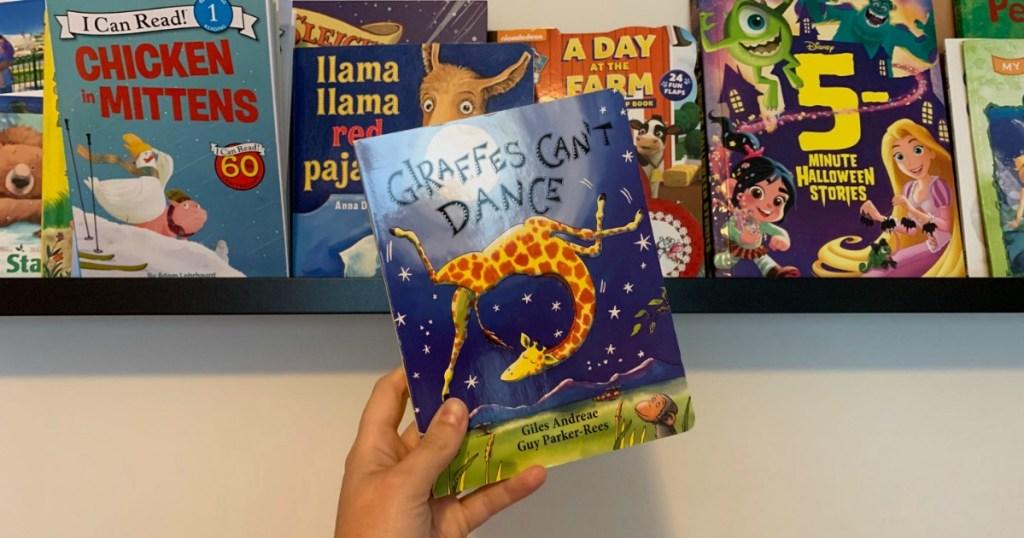 Giraffes Can't Dance book in front of bookshelf