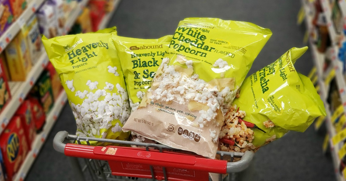 cvs cart filled with four bags of abound popcorn